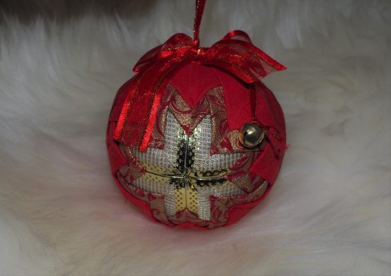 red ornament with bell